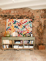 A large photograph of multicoloured paint swatches is displayed on a vintage wooden sideboard in the living room