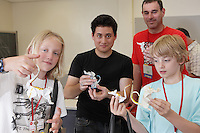 New York, NY, USA - June 26, 2011: Jason Ku, second from left, MIT student and Origami designer with some of his students at OrigamiUSA's convetion in NYC. Jason has been teaching Eric Joisel's Rat. Joisel, a famous designer, died earlier in the year.