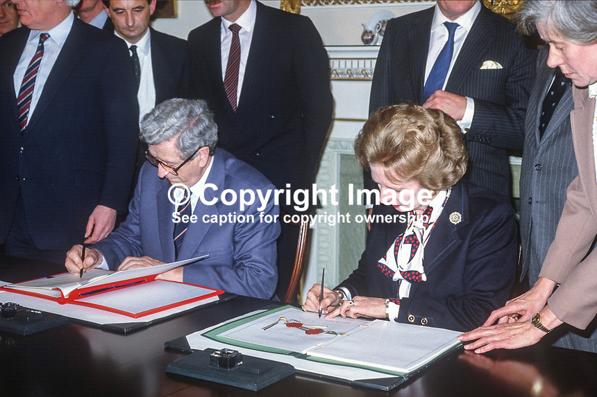 Signing of Anglo-Irish Agreement by Margaret Thatcher, Prime Minister, UK, and Garret Fitzgerald, Prime Minister, An Taoiseach, Rep of Ireland, at Hillsborough Castle, N Ireland, 15th November 1985.1985111505p.<br />