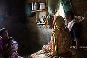 Dr. Sharon Cynthia (right) speaks with 22 year old Seema Devi and her mother in law, Umrawati Devi in their hut in Khurmaniya village in Raxaul district of Bihar. Seema Devi lost 5 of her children and her 6th child, Krishna was born in a government hospital. She is doing everything to make sure her son stays healthy.