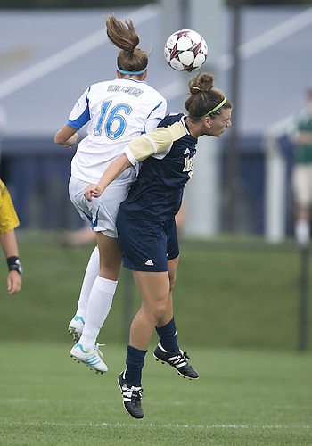 September 01, 2013:  UCLA midfielder Sarah Killion (16) and Notre Dame forward Cari Roccaro (5) go up to head the ball during NCAA Soccer match between the Notre Dame Fighting Irish and the UCLA Bruins at Alumni Stadium in South Bend, Indiana.  UCLA defeated Notre Dame 1-0.