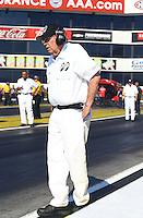 Feb 6, 2015; Pomona, CA, USA; Jim Dunn , team owner of NHRA funny car driver John Hale during qualifying for the Winternationals at Auto Club Raceway at Pomona. Mandatory Credit: Mark J. Rebilas-