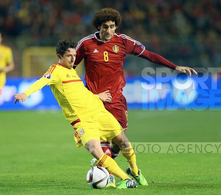 Belgium's Marouane Fellaini tussles with Wales' Joe Allen<br /> <br /> - European Qualifier - Belgium vs Wales- Heysel Stadium - Brussels - Belgium - 16th November 2014  - Picture David Klein/Sportimage