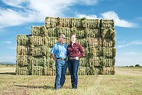 Carl Trick with his daughter Curran Trick on their hay farm in Cowdrey, Colorado, Sunday, August 23, 2015.<br /> <br /> Photo by Matt Nager