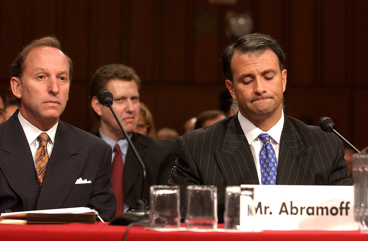"At right, Jack Abramoff, a former Indian gaming lobbyist, appears before a oversight hearing to investigate ""Lobbying Practices Involving Indian Tribes."", along with his attorney Abby Lowell. Abramoff and Michael Scanlon, who failed to appear, are accused of charging exuburent fees and unethical behavoir in dealing with the tribes the represented.  Abramoff invoked his Fifth Amendment Right of self incrimination."