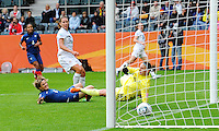 Lauren Cheney (C) of team USA scores 1:0 against goalkeeper Berangere Sapowicz of team France during the FIFA Women's World Cup at the FIFA Stadium in Moenchengladbach, Germany on July 13th, 2011.