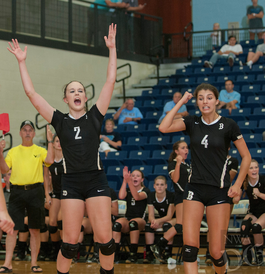 STAFF PHOTO ANTHONY REYES &bull; @NWATONYR<br /> Anna LeDuc (2) and Sadie Pate of Bentonville celebrate a point against Springdale Har-Ber Tuesday, Sept. 9, 2014 at Wildcat Arena in Springdale.