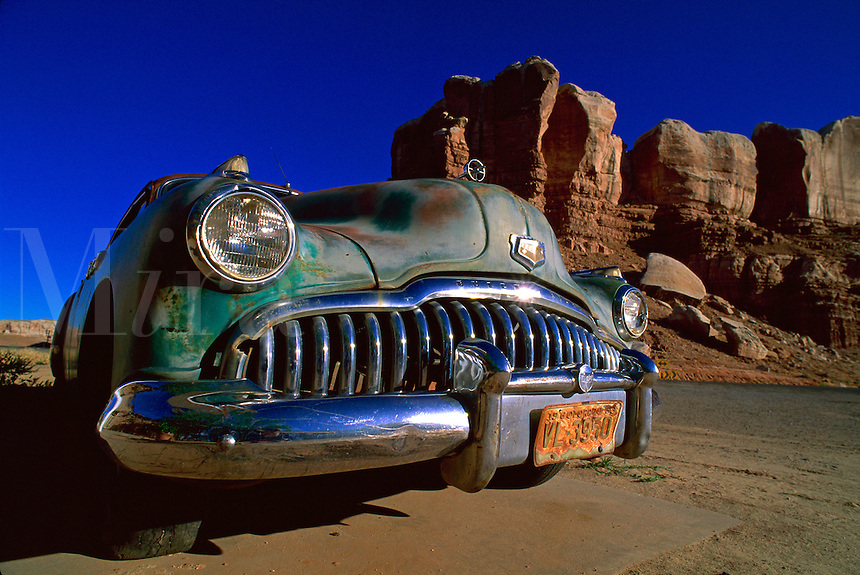 Detail of the grille of a classic Buick car set in the desert.