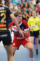 30 MAY 2012 - LONDON, GBR - Lyn Byl (GBR) of Great Britain (right) looks for a way through the Montenegro defence during the women's 2012 European Handball Championship qualification match at the National Sports Centre in Crystal Palace, Great Britain .(PHOTO (C) 2012 NIGEL FARROW)