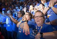 NWA Democrat-Gazette/CHARLIE KAIJO Sam's Club shareholders react during the Walmart shareholders meeting, Friday, June 7, 2019 at the Bud Walton Arena in Fayetteville.