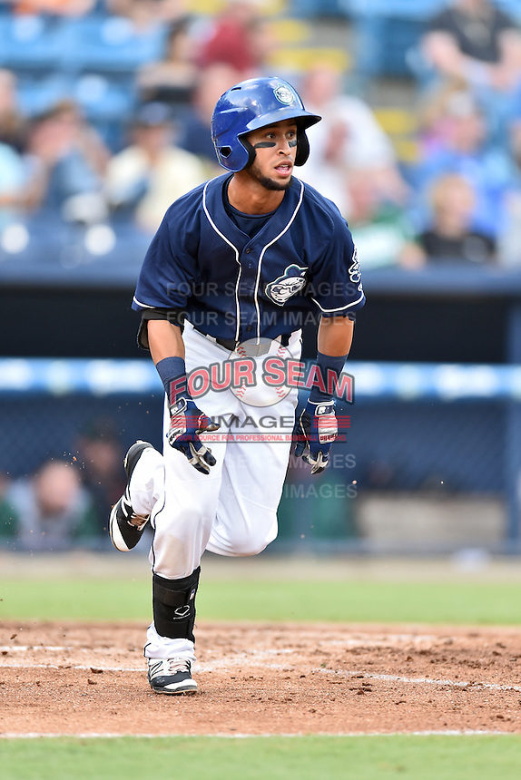Asheville Tourists second baseman Carlos Herrera (46) runs to first base during a game against the Augusta GreenJackets at McCormick Field on August 6, 2016 in Asheville, North Carolina. The GreenJackets defeated the Tourists 11-4. (Tony Farlow/Four Seam Images)