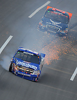 Oct 4, 2008; Talladega, AL, USA; Sparks fly from the truck of NASCAR Craftsman Truck Series driver Jack Sprague (2) after crashing during the Mountain Dew 250 at the Talladega Superspeedway. Mandatory Credit: Mark J. Rebilas-
