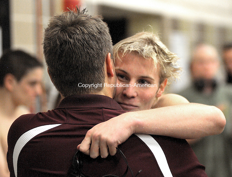 WATERBURY, CT, 02 MARCH  2012-030212JS15-Sacred Heart's Raymond Snyder IV,  gets a hug from his dad and coach Raymond Snyder III as Sacred Heart won the NVL Boys Swim Championships Friday at Kennedy High School in Waterbury. .Jim Shannon Republican-American