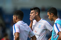 Easah Suliman (Cheltenham Town on loan from Aston Villa) of England U19 covers his face during the International match between England U19 and Netherlands U19 at New Bucks Head, Telford, England on 1 September 2016. Photo by Andy Rowland.