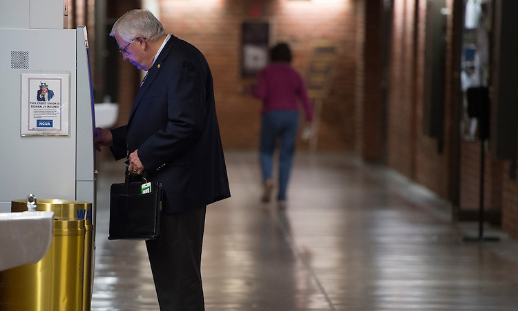 UNITED STATES - APRIL 10: Senate Budget chairman Mike Enzi, R-Wyo., uses the Senate Federal Credit Union ATM in the basement of the Russell Senate Office Building on Friday, April 10, 2015. (Photo By Bill Clark/CQ Roll Call)