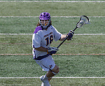 Zach Wolfe (#16) looks for an opening as UAlbany Lacrosse defeats Vermont 14-4  in the American East Conference Championship game at Casey Stadium, May 5.
