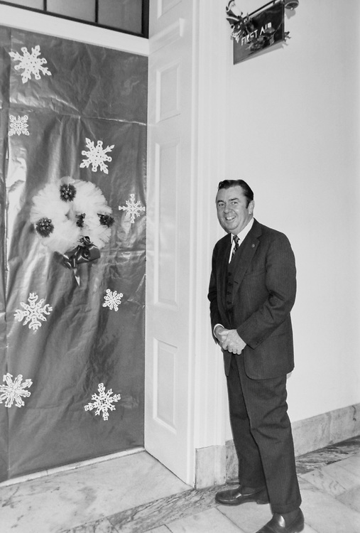 Congressman standing outside decorated first aid room around Christmas. (Photo by Dev O'Neill/CQ Roll Call via Getty Images)