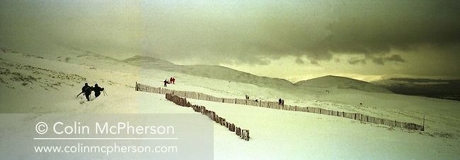 Skiers making their way to the ski lifts at Glenmore in the Cairngorm mountains, part of the Grampian range, and a popular area with skiers and other winter sports enthusiasts.