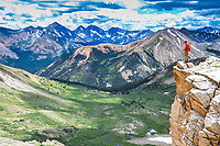 A hiker high on 14,360 foot high La Plata  Peak looks out over the Sawatch Range  in Colorado.