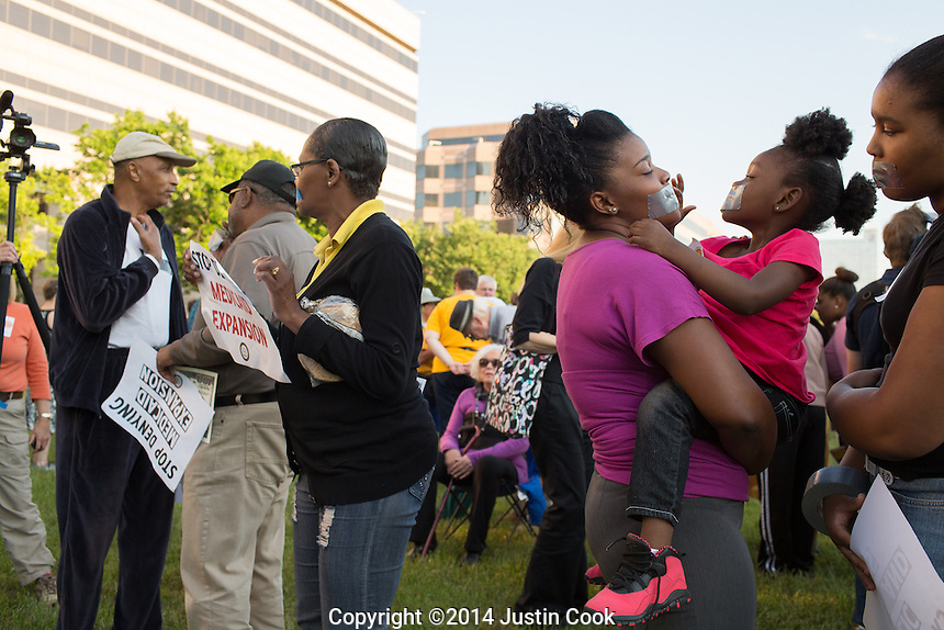 FROM LEFT:  Dominqu &eacute; Penny, her niece Charlize Ward 4, and her sister LeeNiqu&eacute; Penny, 15, (ALL CQ) during the first Moral Monday of 2014 at Halifax Mall in Raleigh, N.C. on Monday, May 19, 2014. (Justin Cook)<br /> <br /> Since 2013 hundreds of people have gathered on Mondays when the North Carolina Legislature is in session to peacefully protest what they feel is a an extreme conservative agenda that endangers education, the poor, the unemployed, voting rights and organized labor in North Carolina. Many of the nonviolent protestors deliberately get arrested in acts of civil disobedience.