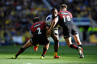 Sitiveni Sivivatu of ASM Clermont Auvergne is tackled by Schalk Brits (left) and Owen Farrell of Saracens during the Heineken Cup semi-final match between Saracens and ASM Clermont Auvergne at Twickenham Stadium on Saturday 26th April 2014 (Photo by Rob Munro)