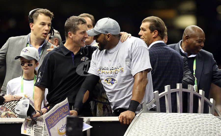 Feb 3, 2013; New Orleans, LA, USA; Baltimore Ravens inside linebacker Ray Lewis (middle) and head coach John Harbaugh (second from left) celebrate after defeating the San Francisco 49ers in Super Bowl XLVII at the Mercedes-Benz Superdome. Mandatory Credit: Mark J. Rebilas-