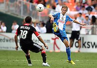 WASHINGTON, D.C. - AUGUST 19, 2012:  Nick DeLeon (18) of DC United watches Brian Carroll (7) of the Philadelphia Union send the ball over his head during an MLS match at RFK Stadium, in Washington DC, on August 19. The game ended in a 1-1 tie.