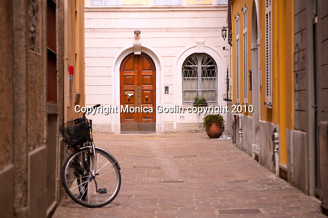Looking down a street in Como, Italy with a bike