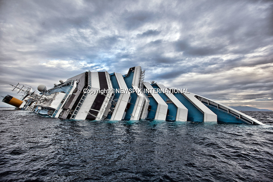 """Isola di Giglio, Italy_16/01/2012:  COSTA CONCORDIA CRUISE TRAGEDY.The luxury cruise ship Costa Concordia, that ran aground on Friday night near Isola del Giglio..The Costa Concordia which was carrying 4,200 people, experienced trouble a few hundred metres from the tiny Tuscan holiday island of Giglio on Friday evening as the passengers were at dinner, after apparently sailing off course..Mandatory Credit Photo: ©Sestini/NEWSPIX INTERNATIONAL..**ALL FEES PAYABLE TO: """"NEWSPIX INTERNATIONAL""""**..IMMEDIATE CONFIRMATION OF USAGE REQUIRED:.Newspix International, 31 Chinnery Hill, Bishop's Stortford, ENGLAND CM23 3PS.Tel:+441279 324672  ; Fax: +441279656877.Mobile:  07775681153.e-mail: info@newspixinternational.co.uk"""