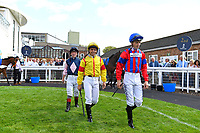 Jockeys enter The Parade Ring during Horse Racing at Salisbury Racecourse on 15th August 2019