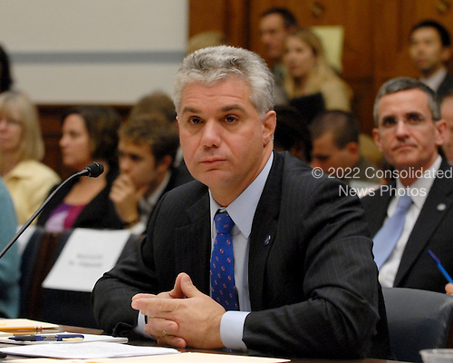 "Washington, D.C. - October 7, 2008 -- Eric R. Dinallo, Superintendent, New York State Insurance Department, listens to the opening statements during the United States House Committee on Oversight and Government Reform hearing on ""The Causes and Effects of the AIG Bailout"" in the Rayburn House Office Building on Tuesday, October 7, 2008..Credit: Ron Sachs / CNP.(RESTRICTION: NO New York or New Jersey Newspapers or newspapers within a 75 mile radius of New York City)"