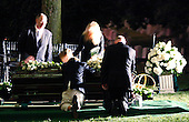 Washington, DC - August 29, 2009 -- U.S. Senator Edward Kennedy's grandchildren kneel over the casket during the burial service for the late Senator at Arlington National Cemetery in Arlington, Virginia, August 29, 2009. Kennedy died late Tuesday after a battle with cancer..Credit: Jim Bourg - Pool via CNP