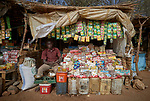 Ibrahim Rabil, a merchant in Gidel, a village in the Nuba Mountains of Sudan, sits in his store. Supplies to the isolated village must come either across enemy lines from the north of the country, or else via a long humanitarian corridor to a refugee camp in South Sudan.