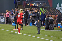 Portland, OR - Saturday, May 21, 2016: Portland Thorns FC head coach Mark Parsons talks with midfielder Allie Long (10). The Portland Thorns FC defeated the Washington Spirit 4-1 during a regular season National Women's Soccer League (NWSL) match at Providence Park.
