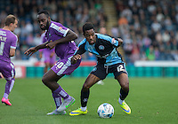Goal scorer Jason Banton of Wycombe Wanderers turns Hiram Boateng of Plymouth Argyle during the Sky Bet League 2 match between Wycombe Wanderers and Plymouth Argyle at Adams Park, High Wycombe, England on 12 September 2015. Photo by Andy Rowland.