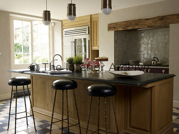 In the kitchen glazed tiles have been used for the splashback around the range cooker which fits snugly into an alcove