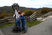 Two young boys check out a viewing telescope at  Grandfather Mountain in the Blue Ridge Mountains of North Carolina.