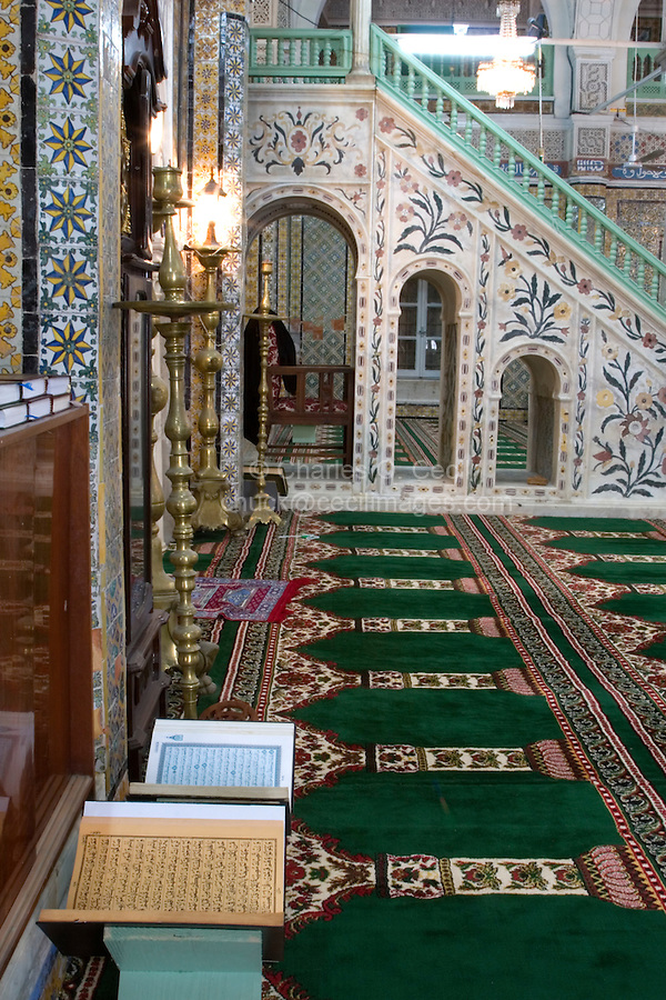 Tripoli, Libya - Gurgi Mosque, Tripoli Medina, showing minbar (pulpit).  Tunisian Tiles.   Floral stonecarving by Moroccan artisans.   Open Korans.  19th. century.  Last Tripoli mosque built during Turkish rule.