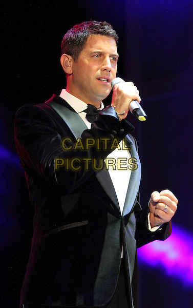 Il Divo.London - BBC Proms in the Park, Hyde Park, London, England..8th September 2012.on stage in concert live gig performance performing music half length black tuxedo bow tie white shirt singing.CAP/ROS.©Steve Ross/Capital Pictures...