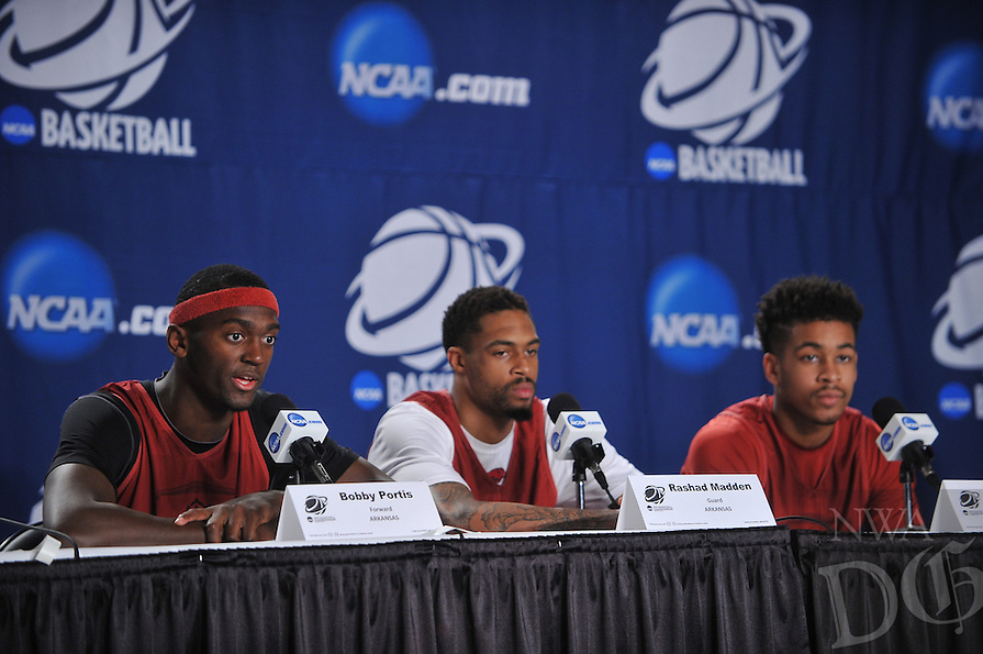 NWA Democrat-Gazette/Michael Woods --03/15/2015--w@NWAMICHAELW... University of Arkansas players Bobby Portis, Rashad Madden and Anton Beard answer questions from the media during a press conference before the Razorbacks practice at Jacksonville Veterans Memorial Arena in Jacksonville, Florida.