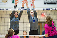 NWA Democrat-Gazette/CHARLIE KAIJO Rogers High School middle blocker Alex Parish (27) and outside hitter Hannah Martin (11) block during the girl's volleyball game on Thursday, October 12, 2017 at Bentonville West High School in Centerton.