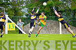 Dr Croke's Shane Myers and James Culhane fail to stop Liam Murphy of Gneeveguilla going for a score in Gneeveguilla last Sunday evening in round 1 of the Garvey's Supervalue County Senior Championship. 5  14  3