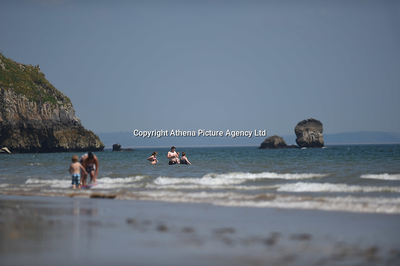 Thursday 25 May 2017<br /> Pictured: People enjoying in the Sea at Tenby <br /> Re: People enjoy the warm sunshine in Tenby, , West Wales. Temperatures today are expected to reach the high 20s Centigrade in many parts of the UK, making it one of  warmest days of the year so far