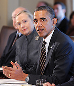 United States President Barack Obama, right, speaks during a Cabinet Meeting as U.S. Secretary of State Hillary Rodham Clinton listens in the Cabinet Room, January 31, 2012 at the White House in Washington, DC. .Credit: Olivier Douliery / Pool via CNP