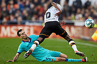 25th January 2020; Mestalla, Valencia, Spain; La Liga Football,Valencia versus Barcelona; Geoffrey Kondogbia of Valencia CF takes on Sergio Busquets of FCB as he slides in