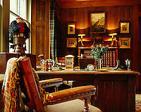 In the study a feeling of solid Victorian comfort has been created with a large antique desk, old prints, retro accessories and traditional tartan curtains