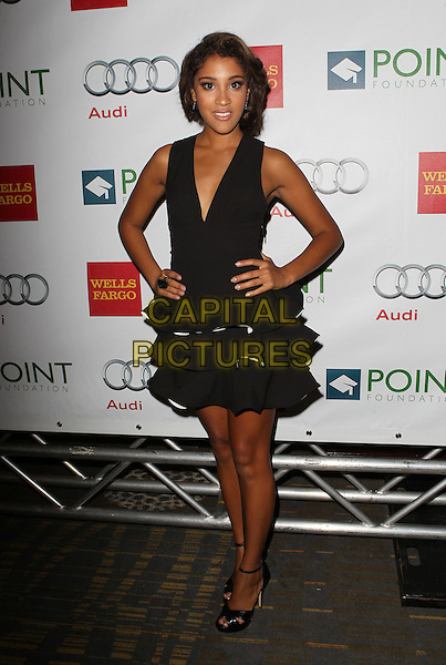 Taylor Bright<br /> &ldquo;Voices on Point&rdquo; iConcert and dinner benefiting Point Foundation Held at The Hyatt Regency Century Plaza, Century City, California, USA, 7th September 2013.<br /> full length black dress ruffles hands on hips <br /> CAP/ADM/KB<br /> &copy;Kevan Brooks/AdMedia/Capital Pictures