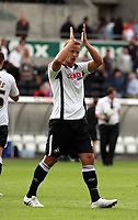ATTENTION SPORTS PICTURE DESK<br /> Pictured: Lee Trundle of Swansea, recently signed from Bristol City, thanking his supporters after the end of the game.<br /> Re: Coca Cola Championship Swansea City Football Club v Watford at the Liberty Stadium, Swansea, south Wales. Saturday 29 August 2009<br /> Picture by D Legakis Photography / Athena Picture Agency, 24 Belgrave Court, Swansea, SA1 4PY, 07815441513