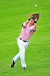 """18 July 2010: Vermont Lake Monsters third baseman Jack Walker pulls in a pop foul during a game  against the Staten Island Yankees at Centennial Field in Burlington, Vermont. The Lake Monsters, dressed in their Breast Cancer Awareness """"Pinks"""", fell to the Yankees 9-5 in NY Penn League action. Mandatory Credit: Ed Wolfstein Photo"""