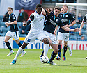 Caley's Edward Ofere and Dundee's Stephen McGinn challenge for the ball.